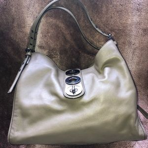 An original Coach in excellent condition. Olive